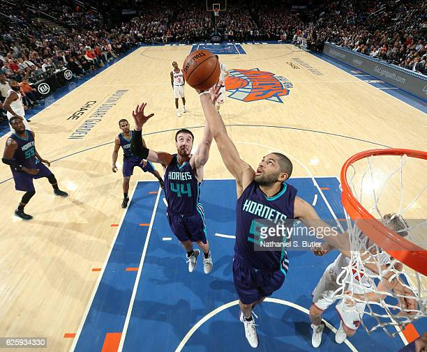 Nicolas Batum and Frank Kaminsky III of the Charlotte Hornets go up for a rebound against the New York Knicks at Madison Square Garden in New York...