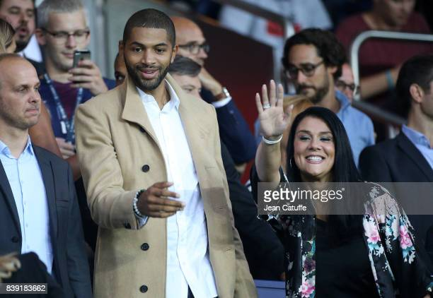 Nicolas Batum and his partner Aurelie Etchart attend the French Ligue 1 match between Paris Saint Germain and AS SaintEtienne at Parc des Princes on...