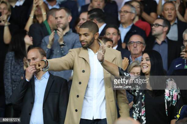 Nicolas Batum and his wife Aurelie attend the French Ligue 1 match between Paris Saint Germain and AS SaintEtienne at Parc des Princes on August 25...