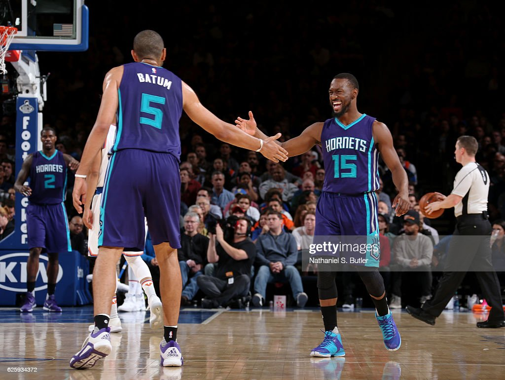 Nicolas Batum #5 and Kemba Walker #15 of the Charlotte Hornets high five during the game against the New York Knicks at Madison Square Garden in New York, New York.