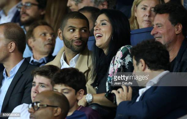 Nicolas Batum of Charlotte Hornets and his companion Aurelie Etchart attend the French Ligue 1 match between Paris Saint Germain and AS SaintEtienne...