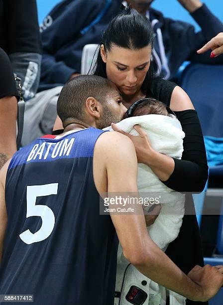 Nicolas Batum of France meets Aurelie and their 7 months old baby son Ayden Richard Batum following the men's basketball match between France and...