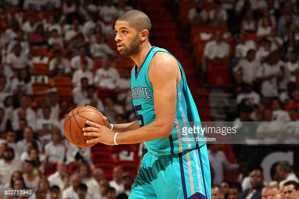 Nicolas Batum of the Charlotte Hornets defends the ball against the Miami Heat during Game Two of the Eastern Conference Quarterfinals during the...