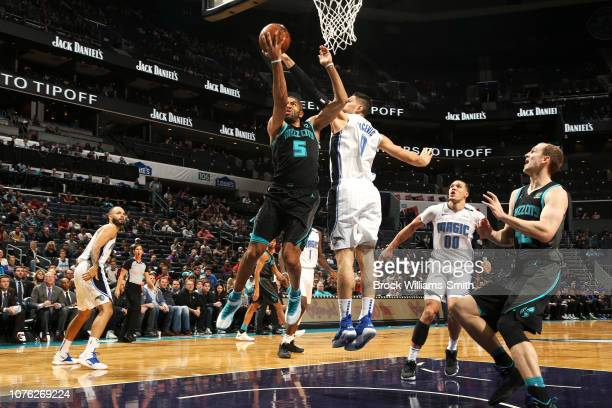 Nicolas Batum of the Charlotte Hornets goes to the basket against the Orlando Magic on December 31 2018 at Spectrum Center in Charlotte North...