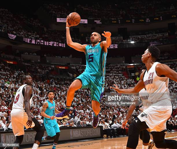 Nicolas Batum of the Charlotte Hornets goes up for the layup against the Miami Heat during the Eastern Conference playoffs First Round Game One on...