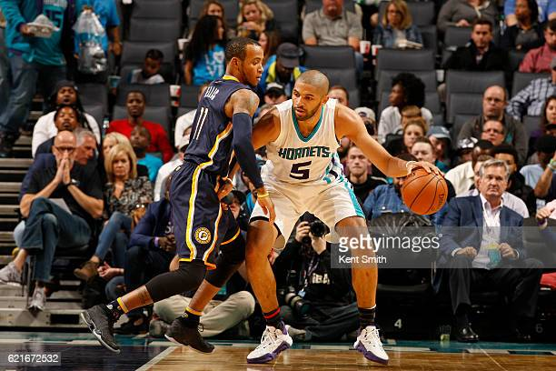 Nicolas Batum of the Charlotte Hornets handles the ball against Monta Ellis of the Indiana Pacers during a game on November 7 2016 at the Spectrum...