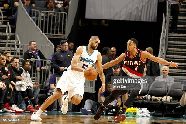 Nicolas Batum of the Charlotte Hornets handles the ball against the Portland Trail Blazers on January 18 2017 at Spectrum Center in Charlotte North...