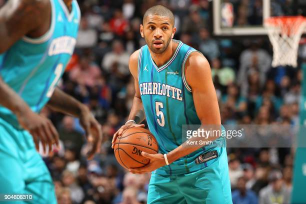 Nicolas Batum of the Charlotte Hornets handles the ball against the Oklahoma City Thunder on January 13 2018 at Spectrum Center in Charlotte North...