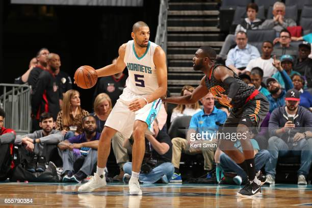 Nicolas Batum of the Charlotte Hornets handles the ball during a game against the Atlanta Hawks on March 20 2017 at Spectrum Center in Charlotte...
