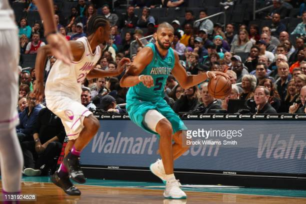 Nicolas Batum of the Charlotte Hornets handles the ball during the game against Andrew Wiggins of the Minnesota Timberwolves on March 21 2019 at...