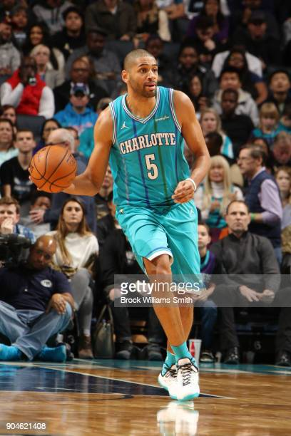 Nicolas Batum of the Charlotte Hornets handles the ball during the game against the Oklahoma City Thunder on January 13 2018 at Spectrum Center in...