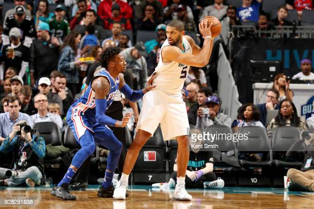 Nicolas Batum of the Charlotte Hornets handles the ball during the game against the Philadelphia 76ers on March 6 2018 at Spectrum Center in...