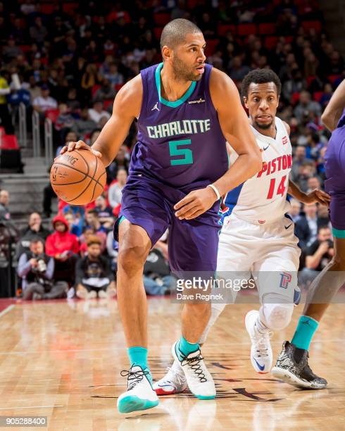 Nicolas Batum of the Charlotte Hornets moves the ball up court in front of Ish Smith of the Detroit Pistons in the first half during the NBA game at...