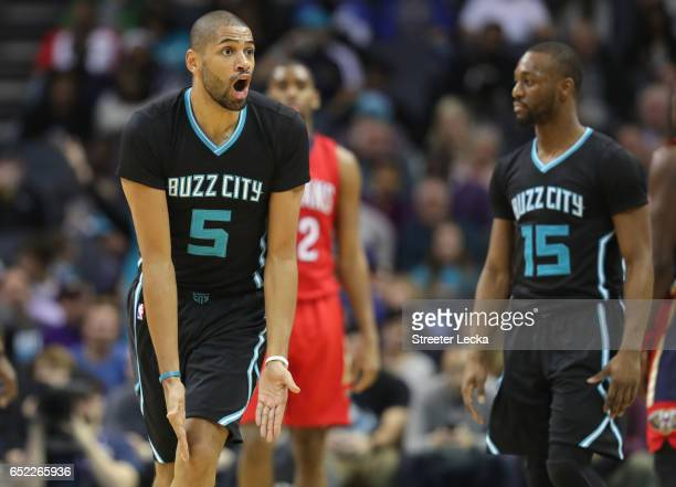 Nicolas Batum of the Charlotte Hornets reacts after a call during their game against the New Orleans Pelicans at Spectrum Center on March 11 2017 in...