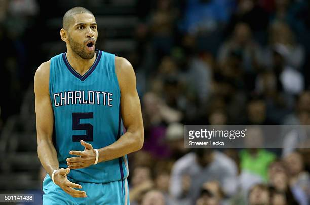 Nicolas Batum of the Charlotte Hornets reacts after a play during their game against the Boston Celtics at Time Warner Cable Arena on December 12...