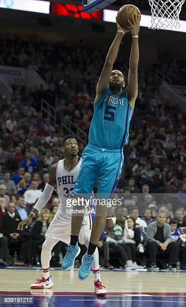 Nicolas Batum of the Charlotte Hornets shoots the ball against Robert Covington of the Philadelphia 76ers at the Wells Fargo Center on January 13...