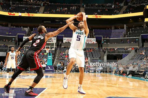 Nicolas Batum of the Charlotte Hornets shoots the ball against the Miami Heat on October 20 2016 at the Spectrum Center in Charlotte North Carolina...