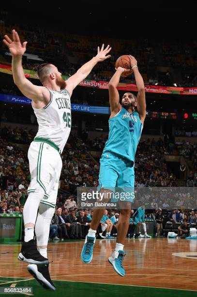 Nicolas Batum of the Charlotte Hornets shoots the ball against the Boston Celtics during a preseason game on October 2 2017 at the TD Garden in...