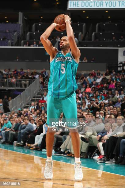 Nicolas Batum of the Charlotte Hornets shoots the ball during the game against the Phoenix Suns on March 10 2018 at Spectrum Center in Charlotte...