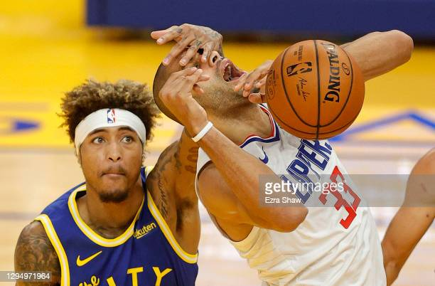 Nicolas Batum of the LA Clippers is fouled by Kelly Oubre Jr. #12 of the Golden State Warriors at Chase Center on January 06, 2021 in San Francisco,...