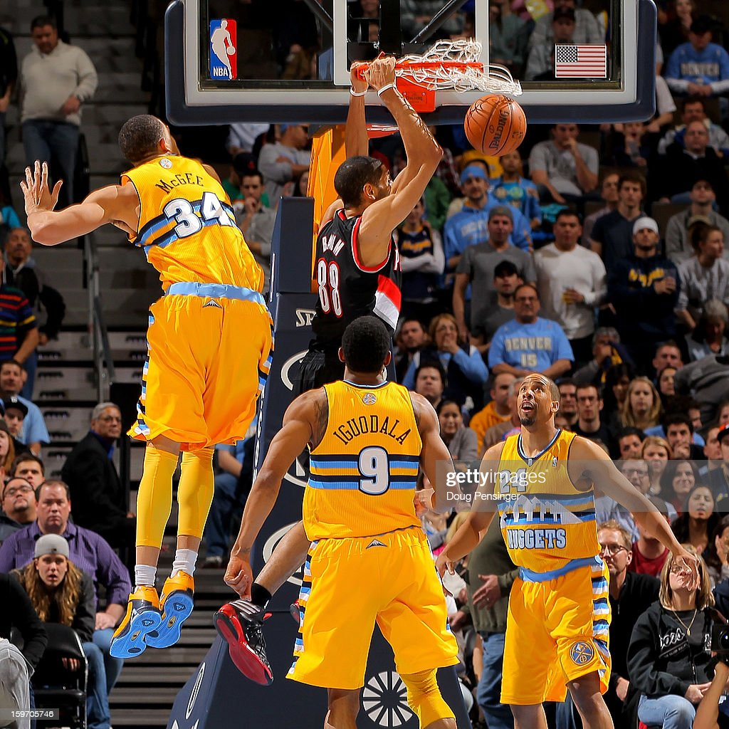 Nicolas Batum #88 of the Portland Trail Blazers dunks the ball against JaVale McGee #34, Andre Iguodala #9 and Andre Miller #24 of the Denver Nuggets at the Pepsi Center on January 15, 2013 in Denver, Colorado. The Nuggets defeated the Trail Blazers 115-111 in overtime.