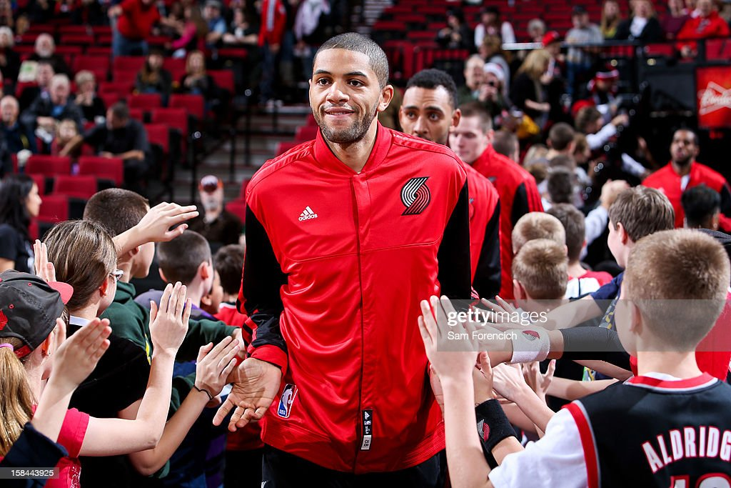 Nicolas Batum #88 of the Portland Trail Blazers greets fans before playing against the New Orleans Hornets on December 16, 2012 at the Rose Garden Arena in Portland, Oregon.