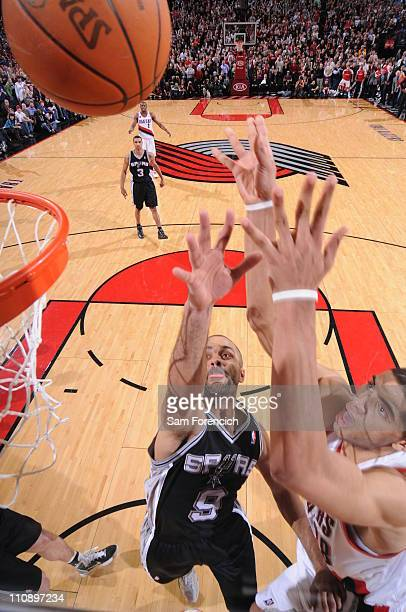 Nicolas Batum of the Portland Trail Blazers makes the gamewinning shot against Tony Parker of the San Antonio Spurs during a game on March 25 2011 at...