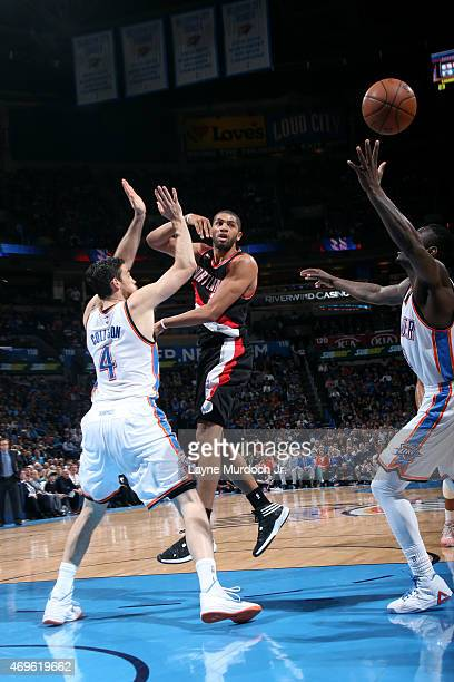 Nicolas Batum of the Portland Trail Blazers passes the ball against the Oklahoma City Thunder on April 13 2015 at Chesapeake Energy Arena in Oklahoma...
