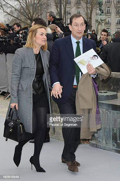 Nicolas Bazire and his wife Fabienne arrive to attend the Christian Dior Fall/Winter 2013 ReadytoWear show as part of Paris Fashion Week on March 1...