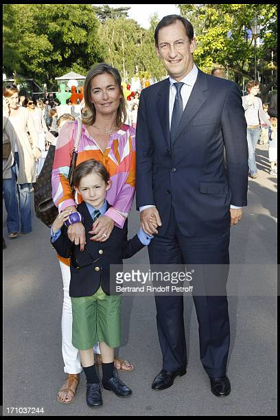 Nicolas Bazire with his wife Fabienne and their son at Jardin D'Acclimatation 150th Anniversary With Les Echos Des Fanfares