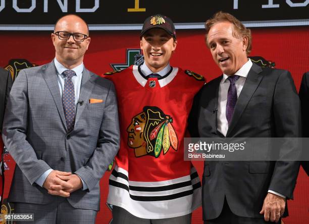 Nicolas Beaudin poses with general manager Stan Bowman after being selected twentyseventh overall by the Chicago Blackhawks during the first round of...