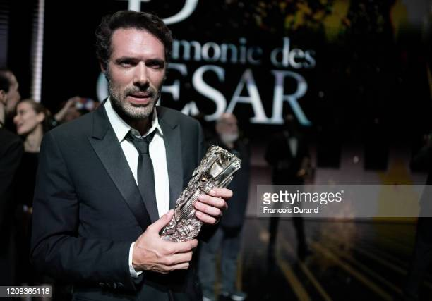 Nicolas Bedos poses with the Best Original Screenplay award for the movie 'La Belle epoque' during the Cesar Film Awards 2020 Ceremony at Salle...