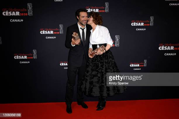 Nicolas Bedos poses with the Best Original Screenplay award next to Fanny Ardant who poses with the Best Actress in a Supporting Role award for the...