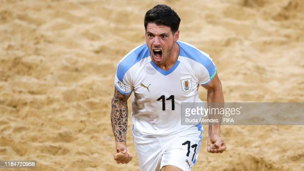 Nicolas Bella of Uruguay celebrates a goal during the FIFA Beach Soccer World Cup Paraguay 2019 group B match between Tahiti and Uruguay at Estadio...