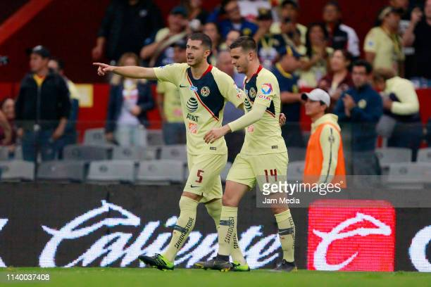 Nicolas Benedetti of America celebrates with teammate after scoring the second goal of his team during the match between America and Tijuana as part...