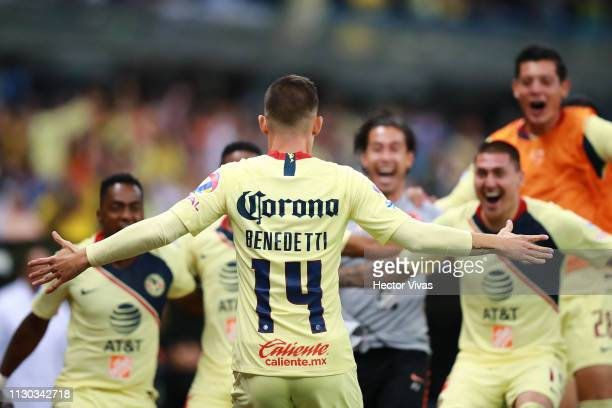 Nicolas Benedetti of America celebrates with teammates after scoring the second goal of his team during the quarterfinals match between America and...
