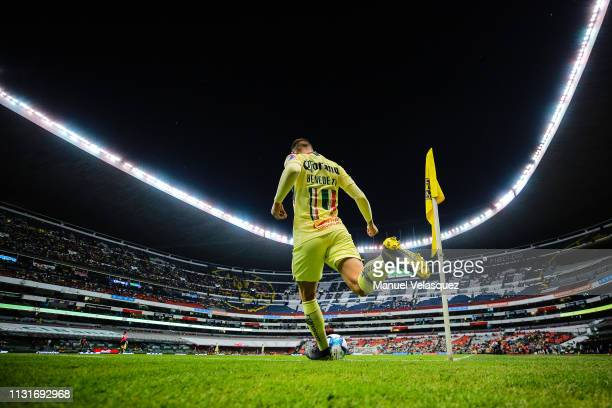 Nicolas Benedetti of America takes a corner kick during the 8th round match between America and Lobos BUAP as part of the Torneo Clausura 2019 Liga...