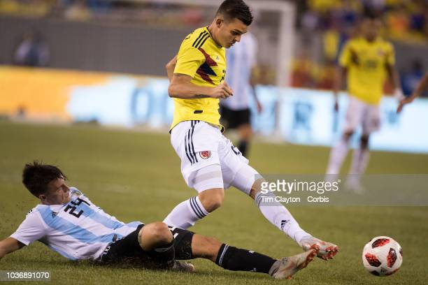 Nicolas Benedetti of Colombia challenged by Franco Cervi of Argentina during the Argentina Vs Colombia International Friendly football match at...