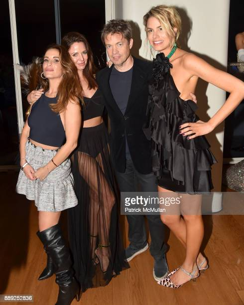 Nicolas Berggruen and Isabelle Bscher pose with guests during the Galerie Gmurzynska Dinner in Honor of Jean Pigozzi at the Penthouse at the Faena...