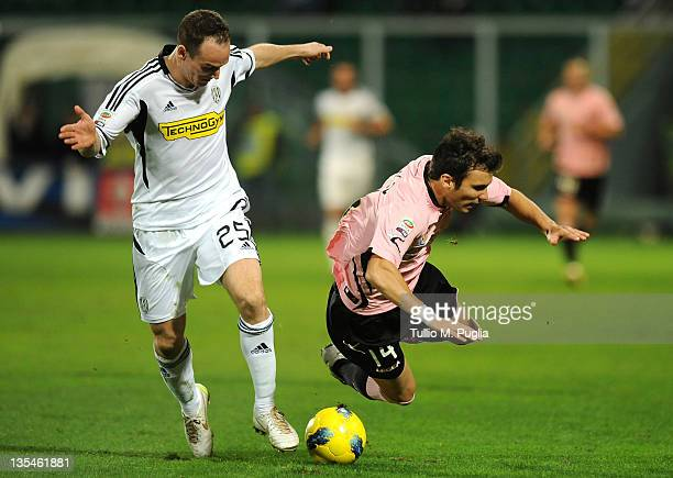Nicolas Bertolo of Palermo and Steve Von Bergen of Cesena battle for the ball during the Serie A match between US Citta di Palermo and AC Cesena at...