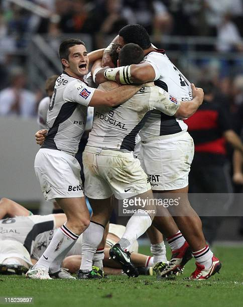 Nicolas Bezy the Toulouse match winner celebrates with team mates after their victory during the French Top 14 Final between Montpellier and Toulouse...