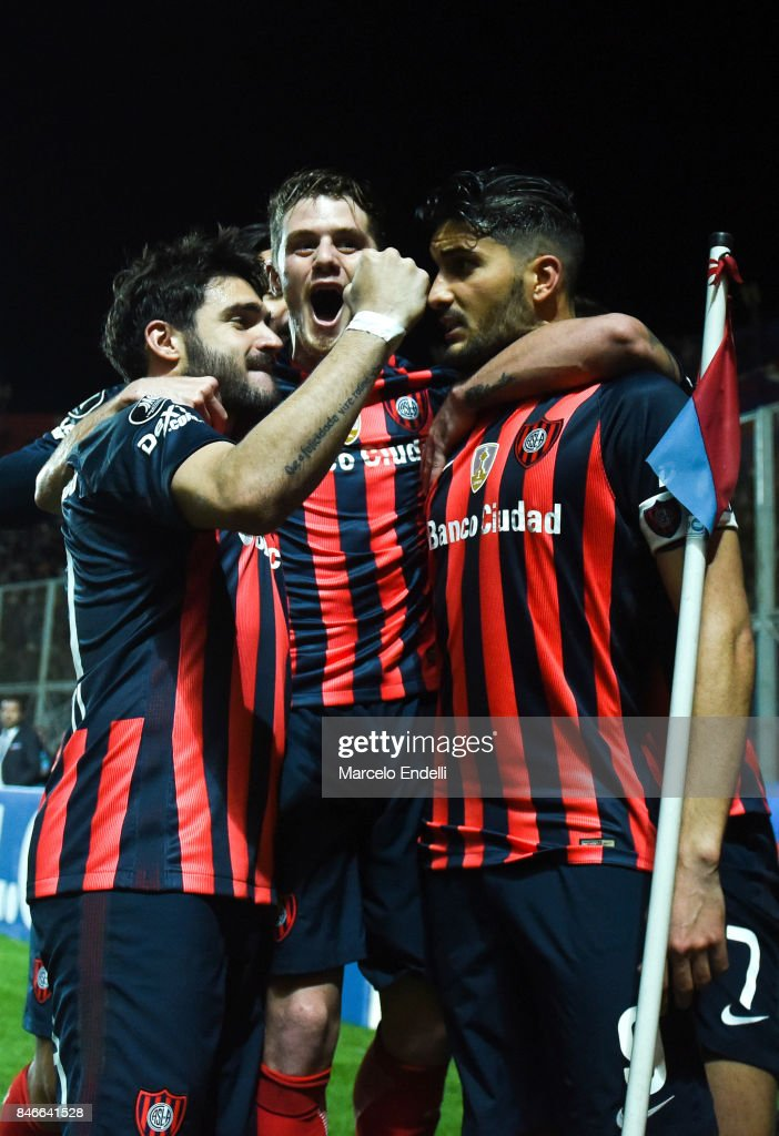 Nicolas Blandi of San Lorenzo celebrates with Bautista Merlini and Ezequiel Cerutti after scoring the second goal of his team with Ezequiel Cerutti and Franco Mussis during a first leg match between San Lorenzo and Lanus as part of the quarter final of Copa CONMEBOL Libertadores Bridgestone 2017 at Pedro Bidegain Stadium on September 13, 2017 in Buenos Aires, Argentina.