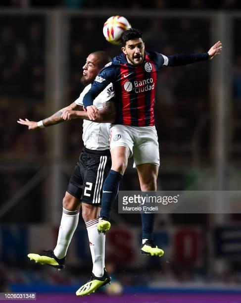 Nicolas Blandi of San Lorenzo fights for the ball with Jonathan Maidana of River Plate during a match between San Lorenzo and River Plate as part of...