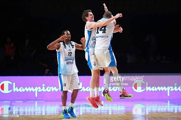 Nicolas Borsellino of Uruguay celebrates with his teammates during a match between Uruguay and Brazil as part of the 2015 FIBA Americas Championship...