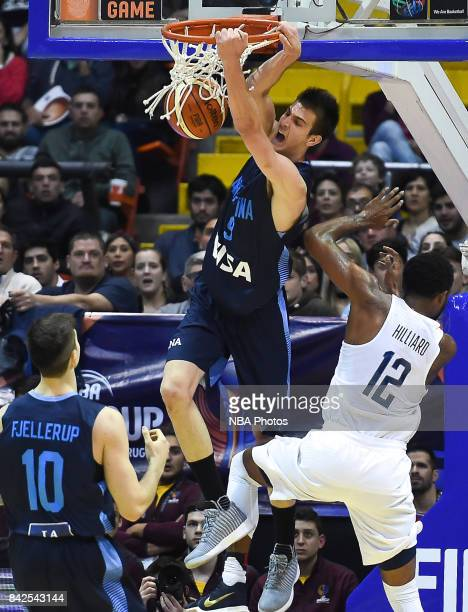 Nicolas Brussino of Argentina dunks the ball against Darrun Hilliard II of United States during the FIBA Americup final match between US and...