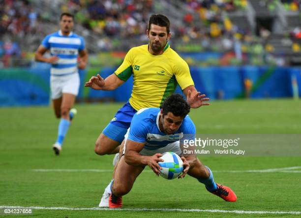 Nicolas Bruzzone of Argentina gathers the ball and dives over for a try during the Men's Rugby Sevens Pool A match between Argentina and Brazil on...