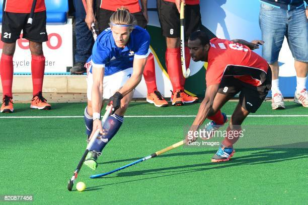 Nicolas Bumont of France tackled by Amr Ibrahim of Egypt during day 8 of the FIH Hockey World League Men's Semi Finals 7th8th place match between...