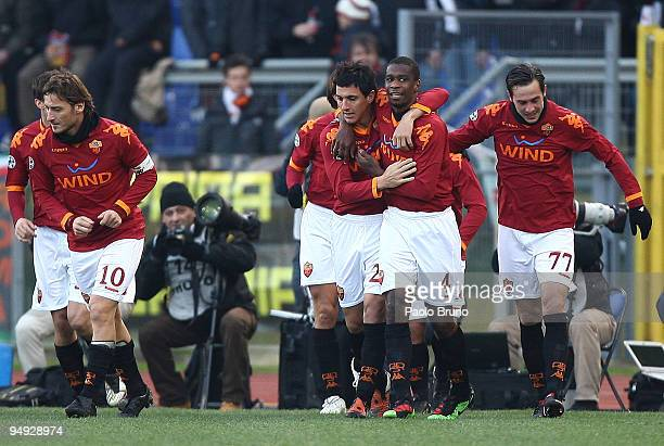 Nicolas Burdisso of AS Roma celebrates his openinig goal with teammates Juan Marco Cassetti Francesco Totti during the Serie A match between AS Roma...