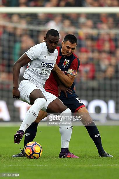 Nicolas Burdisso of Genoa CFC battles for the ball with Duvan Zapata of Udinese Calcio during the Serie A match between Genoa CFC and Udinese Calcio...