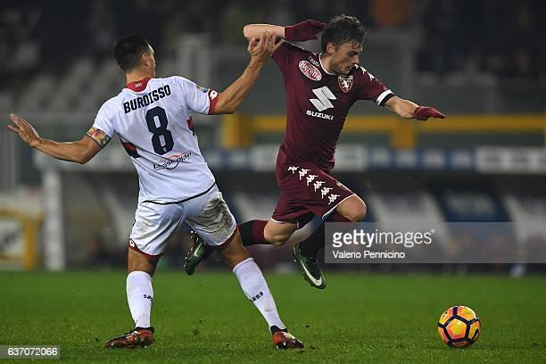 Nicolas Burdisso of Genoa CFC tackles Adem Ljajic of FC Torino during the Serie A match between FC Torino and Genoa CFC at Stadio Olimpico di Torino...